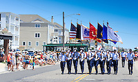Coast Guard members march during the Independence Parade Saturday July 2, 2016 on Beach Avenue in Cape May, New Jersey. Photo by William Thomas Cain/Cain Images