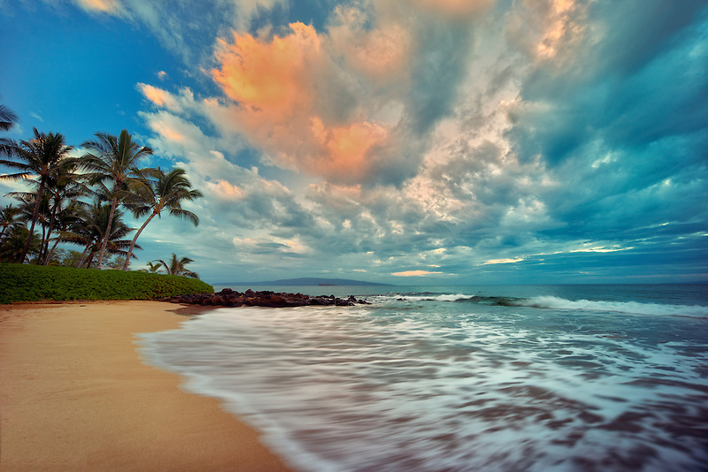 Sunrise ocean waves and palm trees on beach. Maui, Hawaii