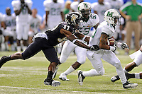 20 December 2011:  FIU wide receiver Mike Jean-Louis (87) chases down Marshall wide receiver Andre Booker (19) during a punt return in the second quarter as the Marshall University Thundering Herd defeated the FIU Golden Panthers, 20-10, to win the Beef 'O'Brady's St. Petersburg Bowl at Tropicana Field in St. Petersburg, Florida.