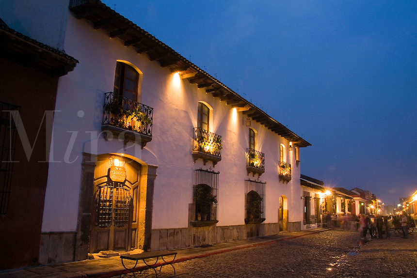 Colorful street scene with cobblestone at 8th Ave Calle at night in tourist village of Antigua Guatemal