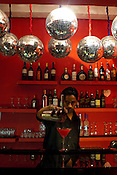 The barman pours a cocktail at The Zoo, a funky nightclub located in the south of New Delhi, India. Photograph: Sanjit Das/Panos