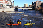 Several unidentified kayakers take advantage of the surging Truckee River, in downtown Reno, Nev., on Sunday, Dec. 2, 2012, as a heavy, wet storm hits the Northern Nevada region. The storm delivered more snow and less rain than forecast, blunting the flood danger. (AP Photo/Cathleen Allison)