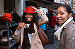 BRUSSELS - BELGIUM - 08 JANUARY 2012 -- Marolles the bohemian city part of Brussels. -- The most famous flee-market of Brussels on Place Jeu de Balle. Onenia Abrancaes having fun trying on hats with her girlfriend Iriana Serra in the hatshop opposite the fleemarket -- PHOTO: Juha ROININEN /  EUP-IMAGES