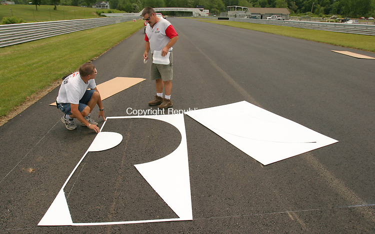 LAKEVILLE, CT- 02 JULY 2008 --070208JS06-Jeff Wood, left and Phil Ghi of Ghi Sign Service, begin to lay out the Lime Rock logo at the start/finish line at Lime Rock Park in Lakeville on Wednesday. <br /> Jim Shannon / Republican-American