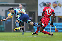 Matthew Bloomfield of Wycombe Wanderers  and Nigel Atangana of Leyton Orient (15) during the Sky Bet League 2 match between Wycombe Wanderers and Leyton Orient at Adams Park, High Wycombe, England on 17 December 2016. Photo by David Horn / PRiME Media Images.