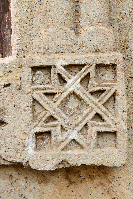 Close up picture & image of the geometric stone bas reliefs on the exterior of the Gelati Georgian Orthodox Church St George, 13th century.  The medieval Gelati monastic complex near Kutaisi in the Imereti region of western Georgia (country). A UNESCO World Heritage Site.