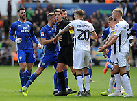 Tempers flare as referee Robert Jones separates the players <br /> <br /> Photographer Ian Cook/CameraSport<br /> <br /> The EFL Sky Bet Championship - Swansea City v Cardiff City - Sunday 27th October 2019 - Liberty Stadium - Swansea<br /> <br /> World Copyright © 2019 CameraSport. All rights reserved. 43 Linden Ave. Countesthorpe. Leicester. England. LE8 5PG - Tel: +44 (0) 116 277 4147 - admin@camerasport.com - www.camerasport.com