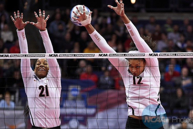 COLUMBUS, OH - DECEMBER 17:  Morgan Johnson (12) and Chloe Collins (21) of the University of Texas jump for a block against Stanford University during the Division I Women's Volleyball Championship held at Nationwide Arena on December 17, 2016 in Columbus, Ohio.  Stanford defeated Texas 3-1 to win the national title. (Photo by Jamie Schwaberow/NCAA Photos via Getty Images)