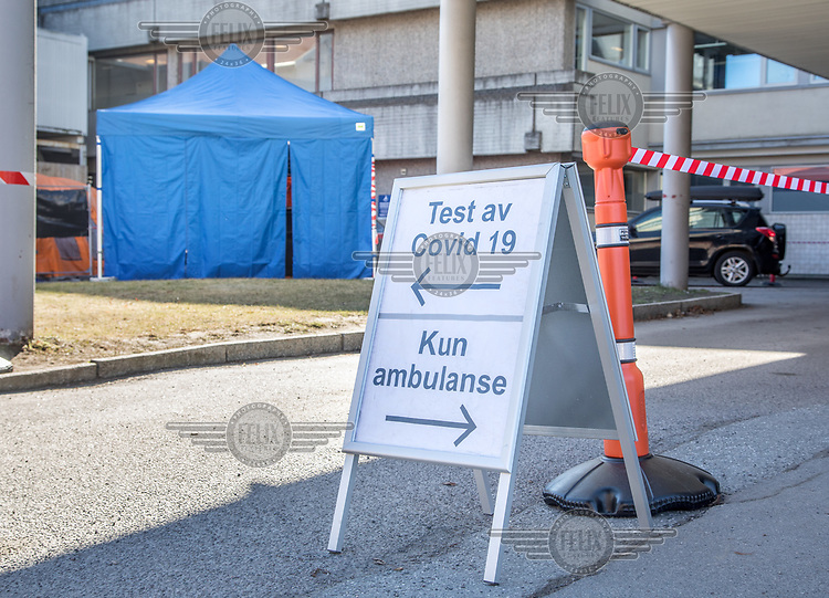 Drive in test at a hospital. Norwegian authorites introduced measures to combat the Coronavirus (COVID-19).<br /> <br /> Restriction on public gatherings, closure of schhols, new rules for those serving food and drinks, and fear of further spread of the virus have brought the country to a stand still. <br /> <br /> ©Fredrik Naumann/Felix Features