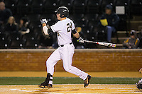 Gavin Sheets (24) of the Wake Forest Demon Deacons follows through on his swing against the Georgetown Hoyas at David F. Couch Ballpark on February 19, 2016 in Winston-Salem, North Carolina.  The Demon Deacons defeated the Hoyas 3-1.  (Brian Westerholt/Four Seam Images)