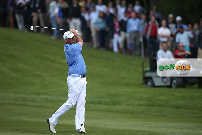Thomas Bjorn (DEN) plays second shot to the par 5 4th during the Final Round of the BMW PGA Championship from Wentworth Golf Club, Virginia Waters, London, UK. Picture:  David Lloyd / www.golffile.ie
