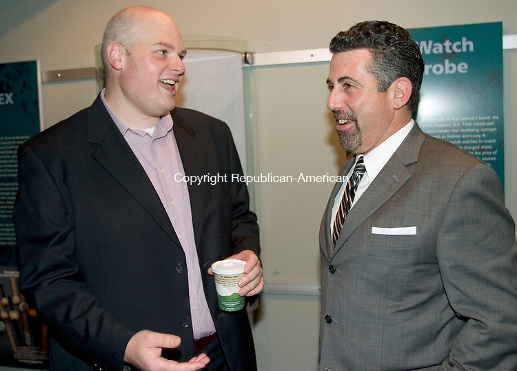 WATERBURY, CT. 27 October 2010-102710SV02--From left, Brian Amero, campaign workplace manager, talks with Joe Gugliotti, campaign co-chair,  during the United Way of Greater Waterbury's annual meeting held at the Timex Museum in Waterbury Wednesday. <br /> Steven Valenti Republican-American