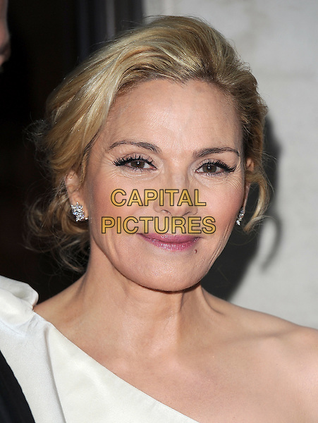 KIM CATTRALL.The Laurence Olivier Awards 2010, Grosvenor House Hotel, London, England..21st March 2010.headshot portrait white one shoulder mascara eyelashes make-up beauty wrinkles .CAP/BEL.©Tom Belcher/Capital Pictures.