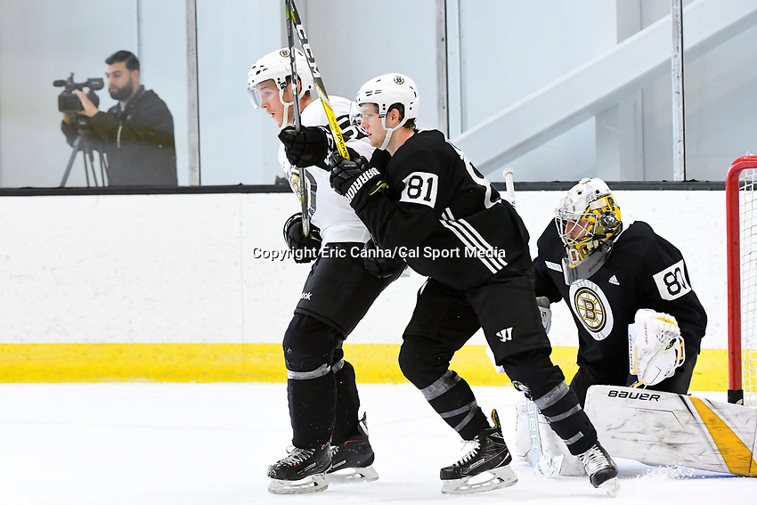 June 28, 2018: Boston Bruins defenseman Olivier Galipeau (56) (white) and forward Mitchell Fossier (81) spar in front of goalie Dan Vladar (80) during the Boston Bruins development camp held at Warrior Ice Arena in Brighton Mass. Eric Canha/CSM