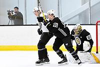 June 28, 2018: Boston Bruins defenseman Olivier Galipeau (56) (white) and forward Mitchell Fossier (81) spar in front of goalie Dan Vladar (80) during the Boston Bruins development camp held at Warrior Ice Arena in Brighton Mass. Eric Canha/CSM