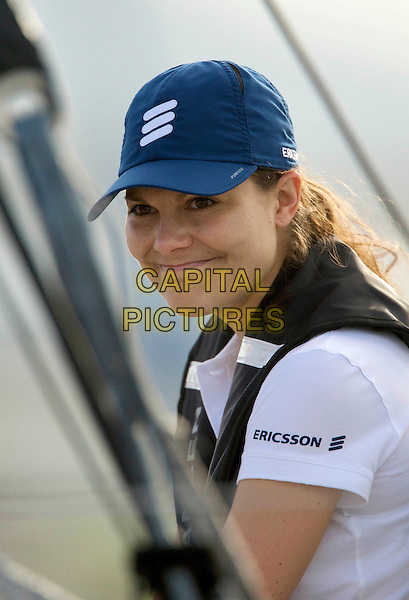 CROWN PRINCESS VICTORIA OF SWEDEN.On board the sail boat Ericsson 4 during the Volvo Ocean Race 2008 - 2009, Marina Gloria, Rio de Janeiro, Brazil, April 3rd 2009..swedish royal family portrait headshot blue cap hat white t-shirt.CAP/PPG/JH.©Jens Hartmann/People Picture/Capital Pictures