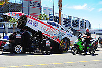 Apr. 4, 2011; Las Vegas, NV, USA: NHRA funny car driver John Force (right) sits alongside the car of his daughter Courtney Force during testing at The Strip in Las Vegas. Mandatory Credit: Mark J. Rebilas-
