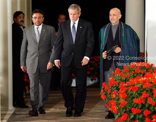 WASHINGTON - SEPTEMBER 27:  (AFP OUT) (L-R) Pakistani President Pervez Musharraf, U.S. President George W. Bush and Afghanistan President Hamid Karzai leave the Oval Office and walk out to the Rose Garden to deliver remarks at the White House September 27, 2006 in Washington, DC. President Bush is hosting a meeting between the two leaders. (AFP OUT)  (Photo by Chip Somodevilla/Getty Images) *** Local Caption *** Hamid Karzai;George W. Bush;Pervez Musharraf