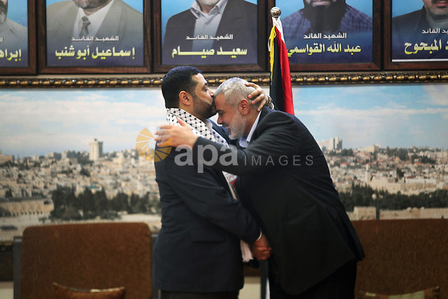Palestinian Prime Minister in Gaza strip, Ismail Haniyeh, meets with the Hamas representative in Lebanon Osama Hamdan, in Gaza city, January 20, 2013. Hamdan visits Gaza strip as a natural right for Hamas leaders to visit their home at the time they want without Israeli restrictions, Hamas sources said. Photo by Ahmed Shaath