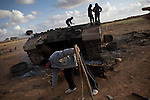 © Remi OCHLIK/IP3 -   Benghazi  March 20, 2011 - Libyan civilians and fighters celebrate the french  airstrike which had destroyed several tank and truck of the Ghadafi loyalist army on the road between Benghazi and Aj Dabiya.