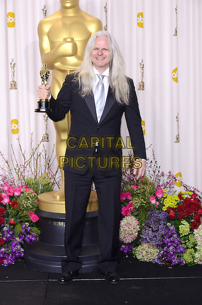 Claudio Miranda.85th Annual Academy Awards held at the Dolby Theatre at Hollywood & Highland Center, Hollywood, California, USA..February 24th, 2013.pressroom oscars full length black white shirt grey gray tie award trophy winner.CAP/ADM/RE.©Russ Elliot/AdMedia/Capital Pictures.