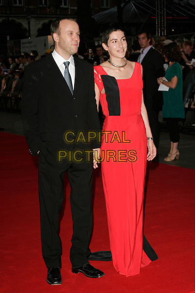 "SAUL DIBB & GUEST.""The Duchess"" World Film Premiere, Odeon Leicester Square, London, England..September 3rd 2008.full length black dress suit.CAP/AH.©Adam Houghton/Capital Pictures."