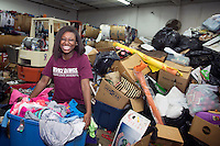 Service DAWGS Day volunteers at Salvation Army sorting donations<br />  (photo by Megan Bean / &copy; Mississippi State University)