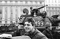 ROMANIA, Revolution square., Bucharest, 24.12.1989.Bukarest Revolution square in the centre: No more bullets. Heavy army tanks fill the place. A soldier is shaving with no water, for Christmas..© Andrei Pandele / EST&OST