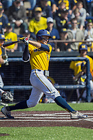 Michigan Wolverines first baseman Jake Bivens (18) swings the bat against the Illinois Fighting Illini during the NCAA baseball game on April 8, 2017 at Ray Fisher Stadium in Ann Arbor, Michigan. Michigan defeated Illinois 7-0. (Andrew Woolley/Four Seam Images)