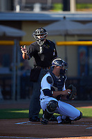 Umpire Mike Savakinas makes a call behind catcher Grayson Greiner during a game between the Lakeland Flying Tigers and Tampa Yankees on April 7, 2016 at Henley Field in Lakeland, Florida.  Tampa defeated Lakeland 9-2.  (Mike Janes/Four Seam Images)