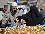 A couple shopping for onions in the market of the Nuseirat refugee camp in the middle of the Gaza strip.  While Gazans grow much of their own food, repressive restrictions on land use imposed by the Israeli military means some food has to be imported at great cost from Egypt and Israel....