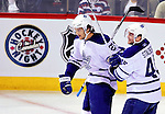 10 April 2010: Toronto Maple Leafs' center Christian Hanson (20) celebrates a goal with left wing forward Viktor Stalberg (45) during the last game of the regular season facing the Montreal Canadiens at the Bell Centre in Montreal, Quebec, Canada. The Leafs defeated the Habs 4-3 in sudden death overtime as the Canadiens advance to the Stanley Cup Playoffs with the single point. Mandatory Credit: Ed Wolfstein Photo