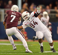 STAFF PHOTO BEN GOFF  @NWABenGoff -- 09/27/14 Arkansas nose guard Taiwan Johnson, right, attempts to sack Texas A&M quarterback Kenny Hill during the second quarter of the game against Texas A&M in the Southwest Classic in AT&T Stadium in Arlington, Texas on Saturday September 27, 2014.