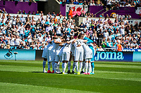 Swansea City team huddle during the Premier League match between Swansea City and West Bromwich Albion at The Liberty Stadium, Swansea, Wales, UK. Sunday 21 May 2017 (Photo by Athena Pictures/Getty Images)