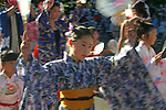Seattle, Kimono clothed young Japanese woman dancer, Bon Odori Festival, Seafair, summer city festival,  Pacific Northwest, Washington State, USA,.