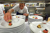 Caribbean cruise with Sea Cloud II. Farewell Gala Dinner. Chef de Cuisine Harm Ro?bel preparing the starter: Composition of Veal Tartare, Melon Soup and Swordfish Tartare.