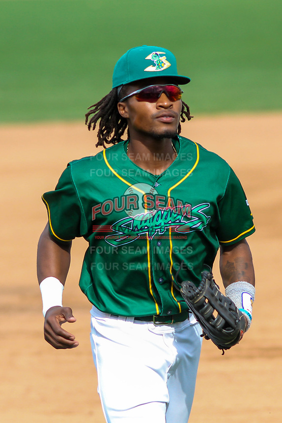 Beloit Snappers outfielder JaVon Shelby (5) jogs in from the outfield during a Midwest League game against the Peoria Chiefs on April 15, 2017 at Pohlman Field in Beloit, Wisconsin.  Beloit defeated Peoria 12-0. (Brad Krause/Four Seam Images)