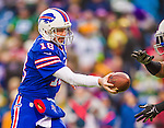 14 December 2014: Buffalo Bills quarterback Kyle Orton makes a hand off in the third quarter against the Green Bay Packers at Ralph Wilson Stadium in Orchard Park, NY. The Bills defeated the Packers 21-13, snapping the Packers' 5-game winning streak and keeping the Bills' 2014 playoff hopes alive. Mandatory Credit: Ed Wolfstein Photo *** RAW (NEF) Image File Available ***