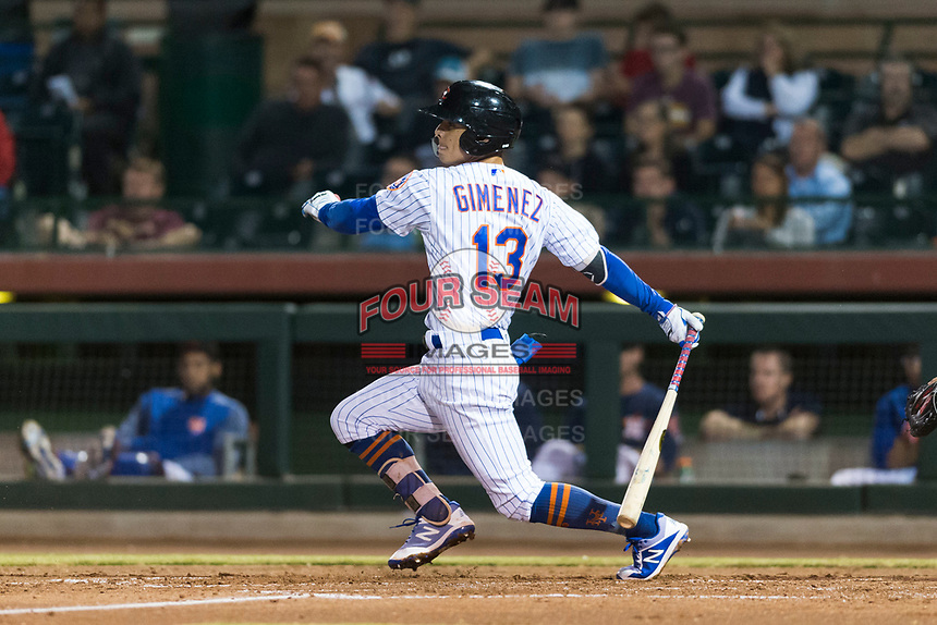 Scottsdale Scorpions second baseman Andres Gimenez (13), of the New York Mets organization, follows through on his swing during an Arizona Fall League game against the Surprise Saguaros at Scottsdale Stadium on October 15, 2018 in Scottsdale, Arizona. Surprise defeated Scottsdale 2-0. (Zachary Lucy/Four Seam Images)