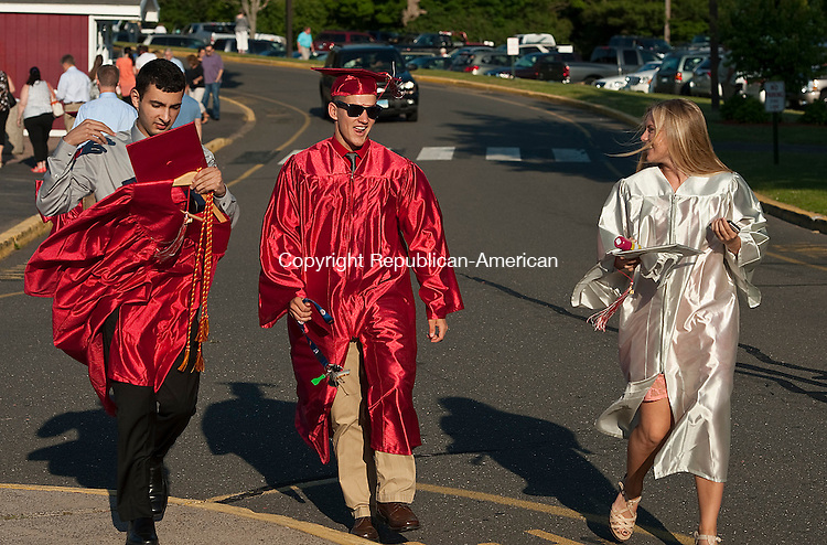 WOLCOTT, CT-062414JS02--Wolcott graduates, from left, Alec Rodriguez, Brandon Lanzara and Morgan Gugliotti make their way into the school prior to graduation ceremonies held Tuesday at Wolcott High School. <br /> Jim Shannon Republican-American