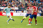 Atletico de Madrid's Koke and Filipe Luis and Celta de Vigo's Jonny during La Liga Match at Vicente Calderon Stadium in Madrid. May 14, 2016. (ALTERPHOTOS/BorjaB.Hojas)