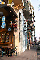 in the San Telmo district around Plaza Dorrego Square, antique and flea market shops displaying furniture dolls, statues and more on the street to passers by Calle Defensa Defence street Buenos Aires Argentina, South America