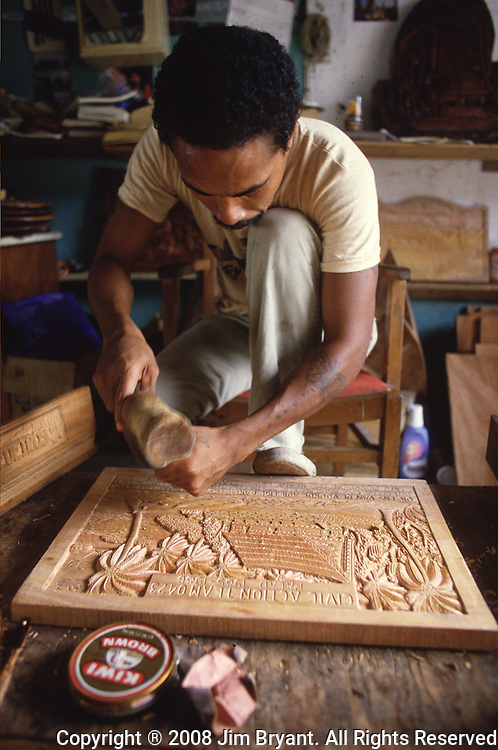 The best place to buy storyboards is at the Koror jail, where inmates put their time to good use by carving traditional storyboards. The island republic of Palau has been everything from a Japanese military base to a U.S. Trust territory it now seeks profitable indignity as a plush Pacific resort. The Republic of Belau lies 1,300 kilometers, southwest of Guam, and 600 kilometers east of the Philippines. (Jim Bryant Photo).....