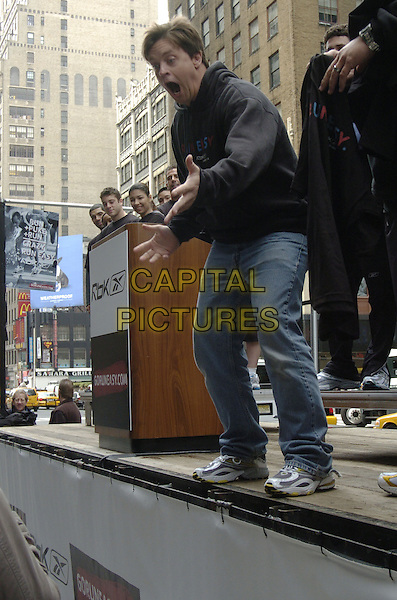 "JIM BREUER.Reebok ""Run Easy"" movement promotion in Times Square, New York City, New York, USA..May 2nd, 2007.full length black hooded top hand mouth open screaming jeans denim funny.CAP/ADM/BL.©Bill Lyons/AdMedia/Capital Pictures *** Local Caption ***"