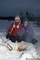 Family outing exploring the ice caves on Lake Superior in winter