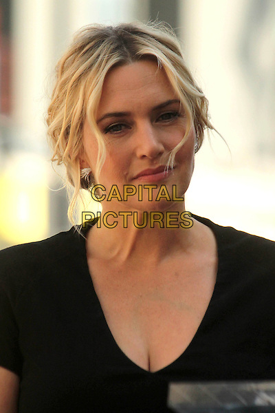 HOLLYWOOD, CA - March 17: Kate Winslet at the Kate Winslet Star on the Hollywood Walk of Fame, Hollywood,  March 17, 2014.  <br /> CAP/MPI/JO<br /> &copy;Janice Ogata/MediaPunch/Capital Pictures