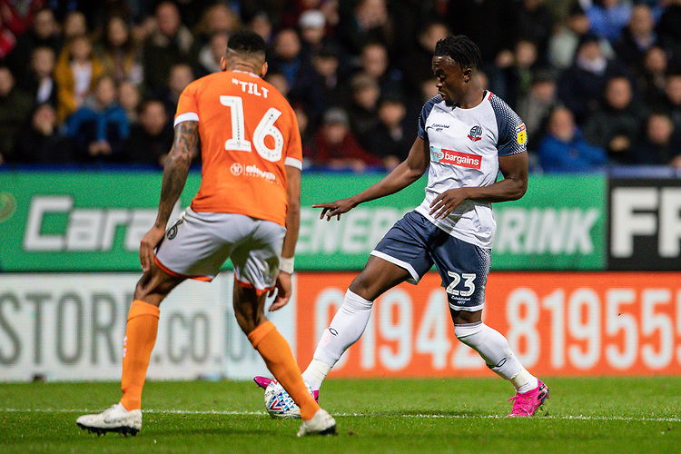 Bolton Wanderers' Joe Dodoo competing with Blackpool's Curtis Tilt (left) <br /> <br /> Photographer Andrew Kearns/CameraSport<br /> <br /> The EFL Sky Bet League One - Bolton Wanderers v Blackpool - Monday 7th October 2019 - University of Bolton Stadium - Bolton<br /> <br /> World Copyright © 2019 CameraSport. All rights reserved. 43 Linden Ave. Countesthorpe. Leicester. England. LE8 5PG - Tel: +44 (0) 116 277 4147 - admin@camerasport.com - www.camerasport.com