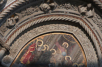 Cathedral Santa Maria del Fiore, Florence, Italy , also known as the Duomo, begun in 1296 by Arnolfo di CAMBIO, dome by Filippo BRUNELLESCHI, 1377-1446, completed in 1436. Detail of mosaic, 19th Century, in the Lunette above the main door: Christ Enthroned with Mary and John the Baptist, designed by Niccolo BARABINO pictured on June 8 2007.