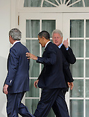 U.S. President Barack Obama (C) leads former Presidents Bill Clinton, who gives a thumbs up, and George W. Bush to the Oval Office after making remarks to the press after their meeting in the  aftermath of the devastating earthquake in Haiti, at the White House in Washington, DC, USA, USA 16 January 2010.  Obama discussed enlisting the help of the American people to help in the recovery and rebuilding of Haiti.     .Credit: Mike Theiler / Pool via CNP