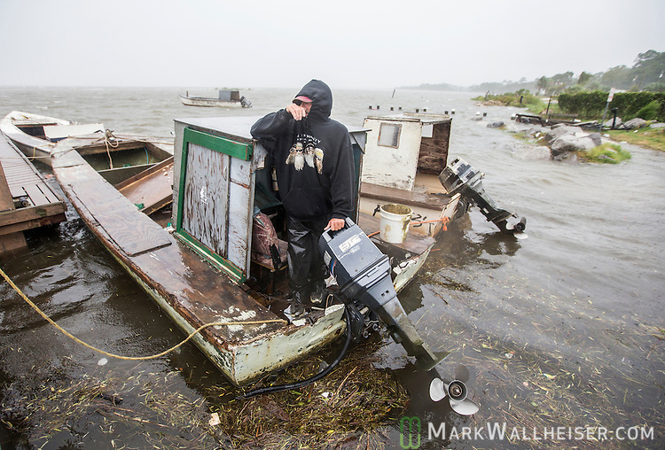 EASTPOINT, FL - SEPTEMBER 01: Oysterman Leon Irvin,  watches watches the storm surge and winds as he checks his boats in Eastpoint, Florida as Hurricane Hermine approaches on September 1, 2016. Hurricane warnings have been issued for parts of Florida's Gulf Coast as Hermine is expected to make landfall as a Category 1 hurricane.  (Photo by Mark Wallheiser/Getty Images)